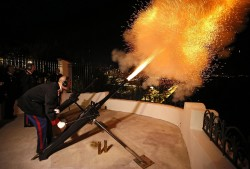 Carabiniers of Monaco's Prince Albert II fire canons to announce the birth of twins of Prince Albert II of Monoco and Charlene, in front of the Monaco Palace December 10, 2014